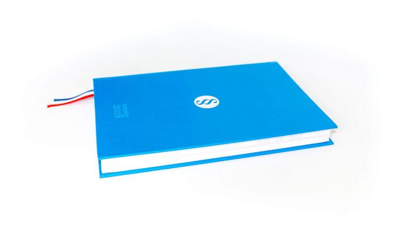 Rokovnici, planeri, reklamne kutije, karte